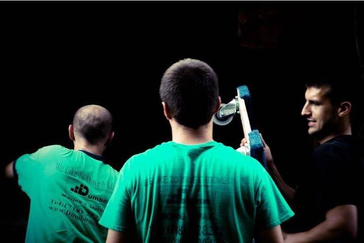 Dumbo movers in their recognizable green shirts